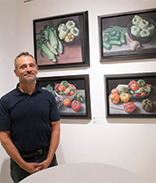 ASL Artist with Vegetable Paintings Thumbnail