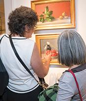 ASL Exhibit Guests Looking at Vegetable Paintings Thumbnail