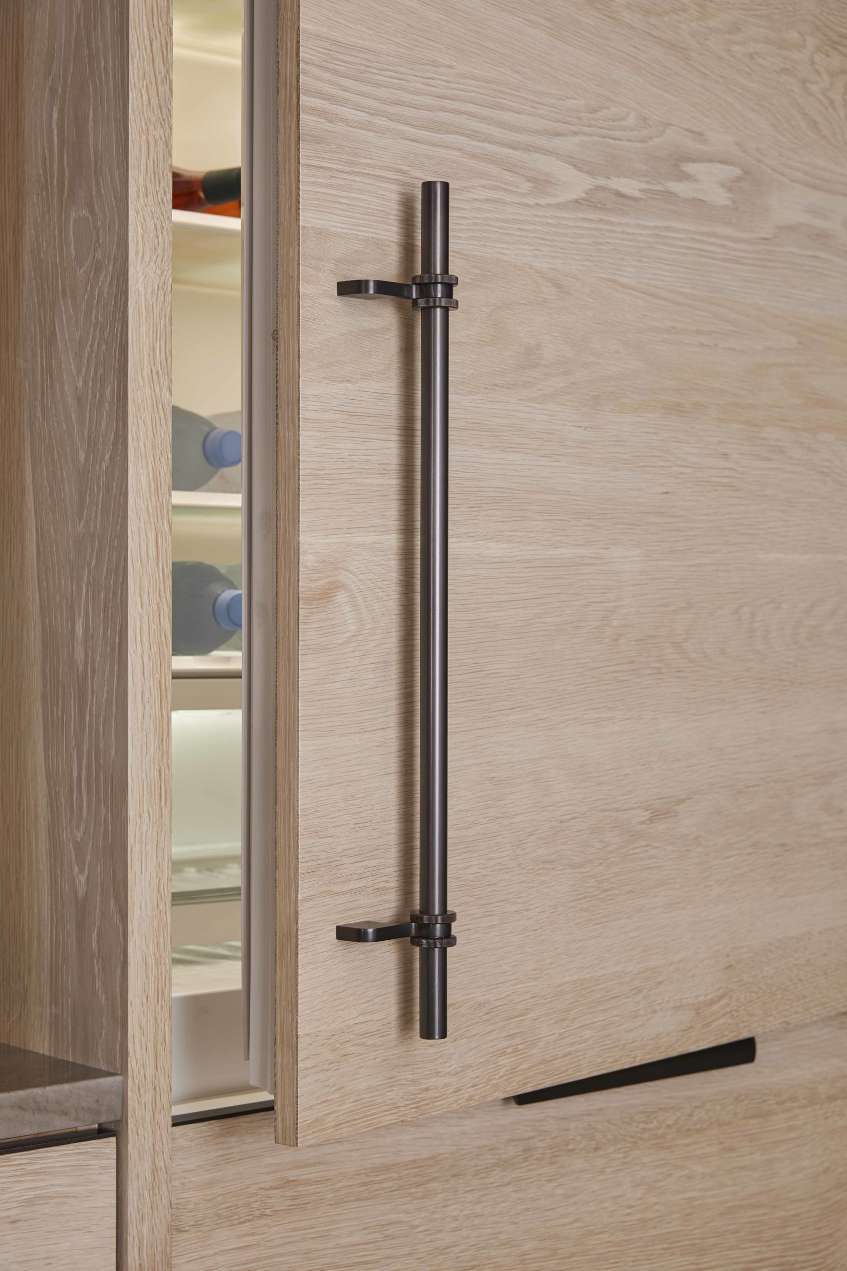 amuneal_products_WNWN_NYDC_nyc-showroom_5Bleached-Oak-Functional-Kitchen-with-Ombre-Upper-Cabinetry-detail-fridge-door-open-scaled-1
